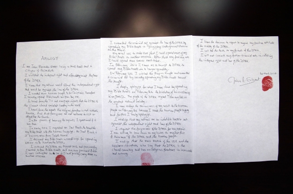 This picture taken by North Korea's official korean Central News Agency (KCNA) on March 1, 2014 and released on March 3 shows a written apology by Australian missionary John Short, who was detained after distribution of religious pamphlets in a Buddhist temple in Pyongyang, at undisclosed place in North Korea.   AFP PHOTO / KCNA via KNS    REPUBLIC OF KOREA