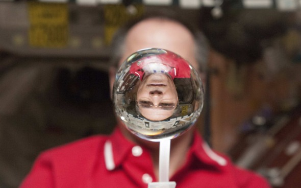Nasa astronaut Kevin Ford watches a water bubble float inside the International Space Station