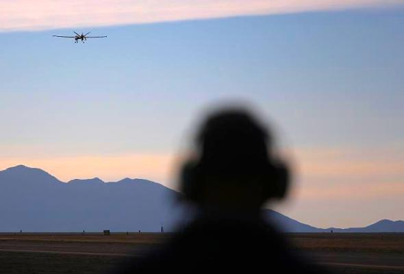A US predator drone takes off for a surveillance flight near the Mexican border on March 7, 2013 (AFP Photo/John Moore)