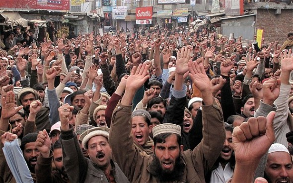 People gather after Friday congregational prayers to protest for the release of Mumtaz Qadri, one of the elite police guard who killed Punjab governor Salman Taseer in 2011