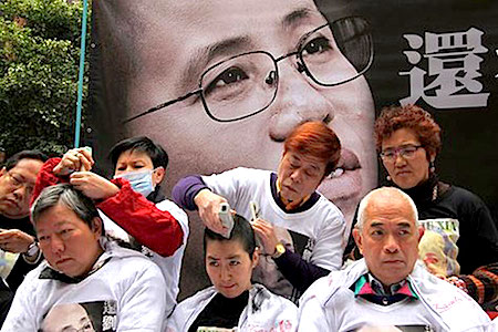 Supporters of Liu Xia and Liu Xiaobo shave their heads on a street in Hong Kong, Feb. 14, 2014. Photo courtesy of a rights activist