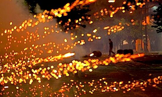 A firecracker explodes at the scene of protests in Caracas, Venezuela. Photograph: Esteban Felix/AP