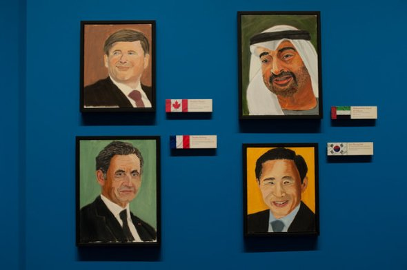 Portraits of (clockwise from bottom left) former  President Nicolas Sarkozy of France, Prime Minister Stephen Harper of Canada, the crown prince of Abu Dhabi, Mohammed bin Zayed, and the former president of South Korea, Lee Myung-bak. All were painted by former President George W. Bush. Credit - Brandon Thibodeaux for The New York Times