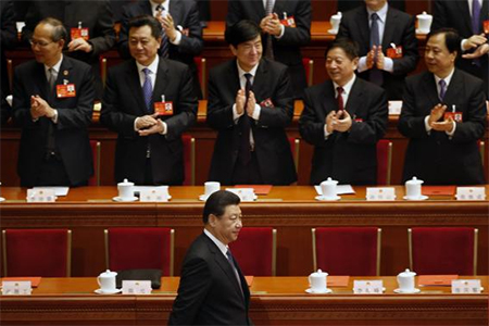 China's President Xi Jinping drinks from a cup during the closing ceremony of the Chinese National People's Congress (NPC) at the Great Hall of the People, in Beijing, March 13, 2014