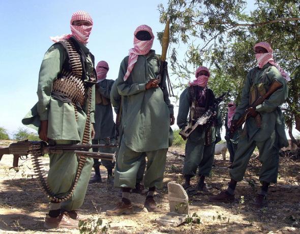 members of Somalia's al-Shabab jihadist movement seen during exercises at their military training camp outside Mogadishu.