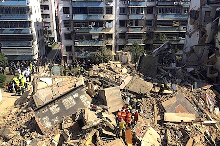 Rescuers carry out search and rescue operation on top of debris of a collapsed residential building in Fenghua, Zhejiang province. Reuters