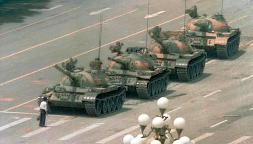 A Chinese man stands alone to block a line of tanks heading east on Beijing's Changan Blvd. in Tiananmen Square on June 5, 1989. (AP/Jeff Widener)