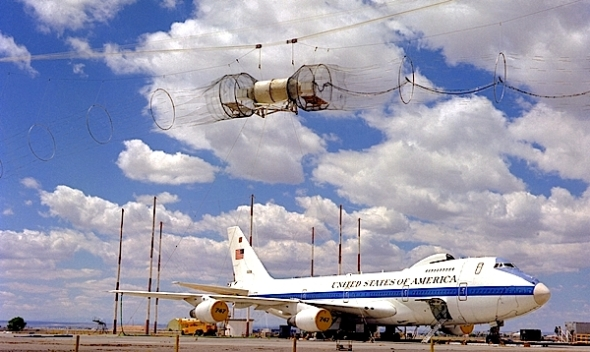 The government testing electromagnetic pulses uses a simulator hanging over an airborne command post.