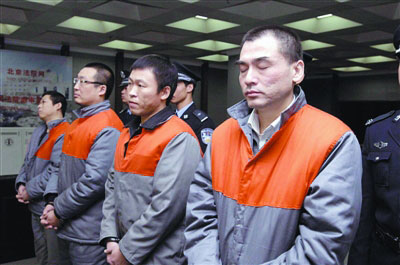 A file photo of Xia Keming(R1) and his three companions (Photo source: people.cn)