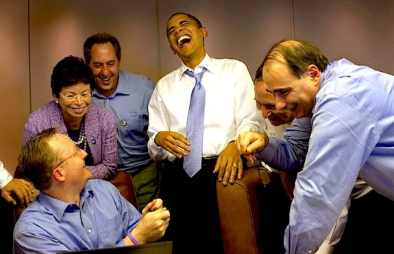 President Obama Laughs with Aides on Air Force One