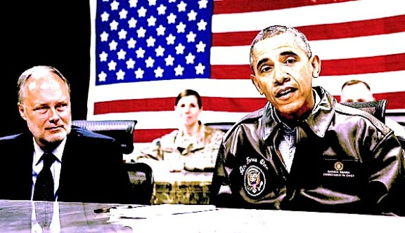 US President Barack Obama attends a military briefing with US Ambassador to Afghanistan James Cunningham (L) at Bagram Air Field, north of Kabul, in Afghanistan, May 25, 2014. Photo: SAUL LOEB/AFP/Getty Images