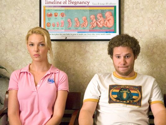 """The First International Conference on Men's Issues touched on many topics, including the treatment of men in the media. Dads are often depicted as bumbling losers, such as the one portrayed by Seth Rogen in the movie """"Knocked Up"""" with Katherine Heigl. (Photo: AFP/Getty Images)"""