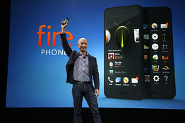 Amazon CEO Jeff Bezos holds up the new Amazon Fire Phone Associated Press