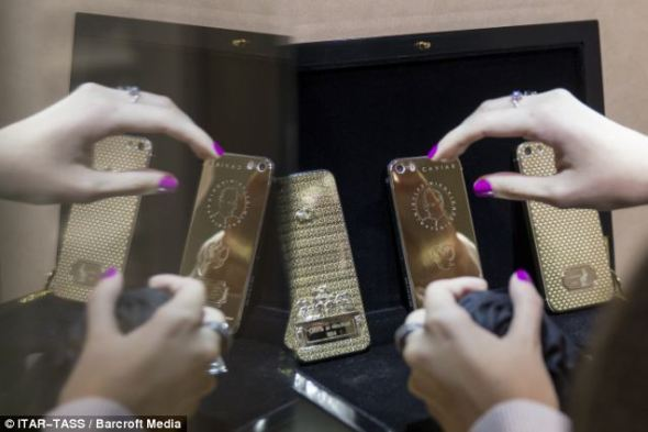 Golden number:The golden iPhones with the portrait of Russian President Vladimir Putin and the lyrics of the National Anthem on sale at Zhukoffka Plaza shopping centre on Moscow, Russia