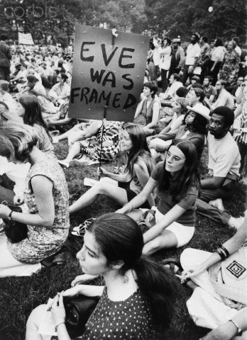 26 Aug 1970 --- Trying to set the record straight, a young woman goes all the way back into Biblical history for a case in point, during a women's liberation demonstration in New York, New York. --- Image by © Bettmann/CORBIS