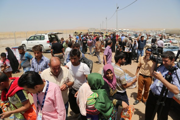ARBIL, IRAQ - JUNE 9: Thousand of people run away from Mosul to Arbil and Duhok due to the clashes between security forces and militants of Islamic State of Iraq and the Levant in Arbil, Iraq on June 9, 2014. (Photo by Emrah Yorulmaz/Anadolu Agency/Getty Images)