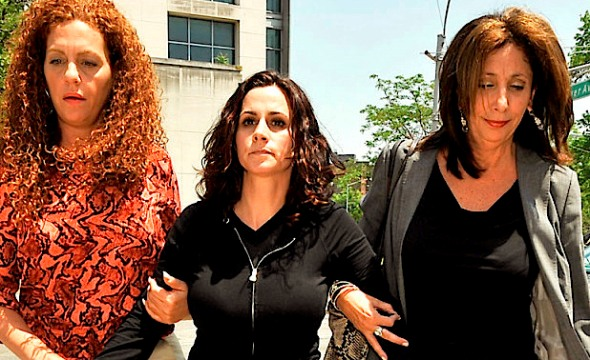 Specializing in Physical Education. Grover Cleveland School PE teacher Joy Morsi (middle, all in black) is lead out of Kew Gardens Courthouse by her lawyer Virginia Lopreto (suit, black top) and Bail Bonds woman Michelle Esquenazi (red designed top) after being arraigned for having sex with a student.