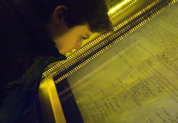 WASHINGTON - DECEMBER 15: Ethan Kasnett, an 8th grade student at the Lab School in Washington, DC, views the original constitution. (Brendan Smialowski/GETTY IMAGES)