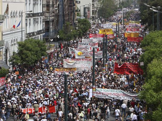 Greeks protest in Athens in 2010. (Photo: Thanassis Stavrakis, AP, 2010)