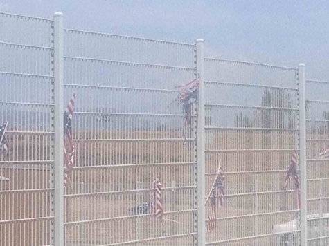 Breitbart News obtained photographs of torn-up flags that pro-amnesty demonstrators had impaled on a fence