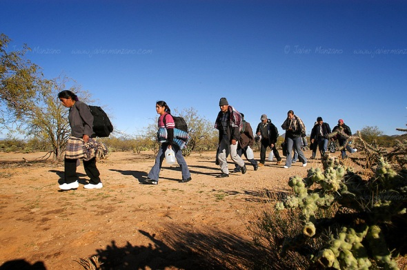"A large group of Immigrants, guided by two ""coyotes"" or guides, walk on the desert of Sonora bound for the border with Arizona. This group consisted of 37 border crossers, from four different countries- They included people from Mexico, Honduras, El Salvador and one Brazilian. Sasabe, Mexico. 01/23/05"