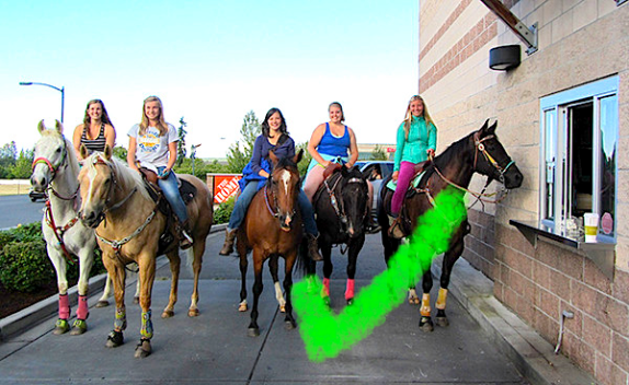 From left, Clara Duncan, Emily Hesse, Alana Linderoth, Hannah Sperber and Ady Crosby and their horses stop outside the drive-through window at Starbucks and wait for their coffee order.— Image Credit: Submitted Photo