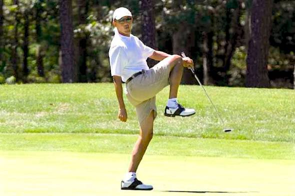President Obama reacting as he misses a shot while golfing on the first hole at Farm Neck Golf Club in Oak Bluffs, Mass., on the island of Martha's Vineyard last year. AP Photo