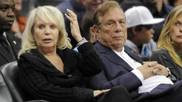 Shelly Sterling sits with her husband, Donald Sterling at a Los Angeles Clippers game. (AP Photo/Mark J. Terrill)