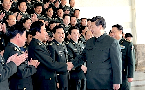 President Xi Jinping, who also serves as chairman of the Central Military Commission, shakes hands with PLA division commanders in Shandong province last year. Photo: Xinhua