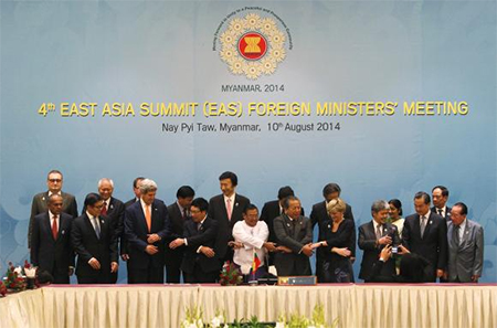 Dignitaries hold hands as they pose for a photo before the 4th East Asia Summit (EAS) Foreign Ministers Meeting at the Myanmar International Convention Centre (MICC) in Naypyitaw, August 10, 2014