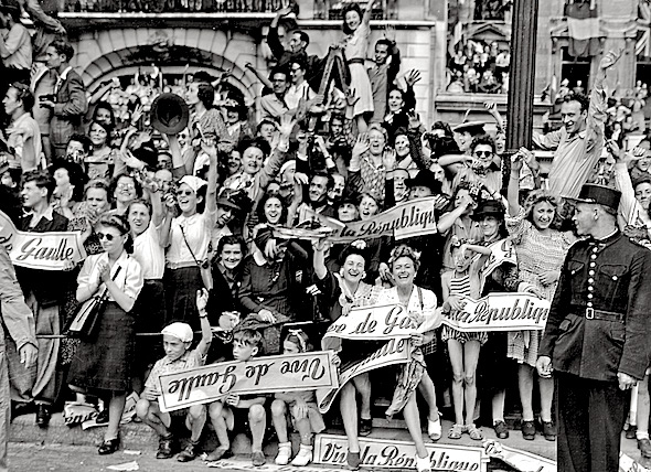 26 Aug 1944: French civilians line the streets to welcome General Charles De Gaulle to liberated Par