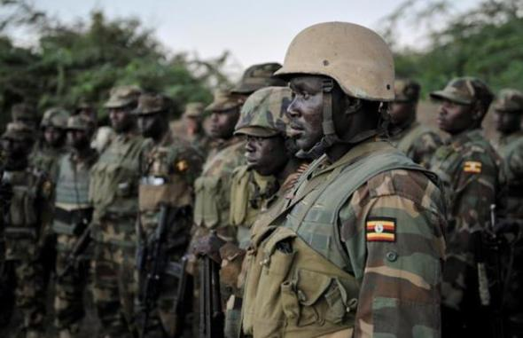 In this photo taken Friday, Aug. 29, 2014, African Union (AU) soldiers from Uganda gather as they prepare to launch an offensive against Al-Shabab strongholds in the Lower Shabelle region of Somalia. (AP/AMISOM, Tobin Jones)  Read more: http://www.dailystar.com.lb/News/Middle-East/2014/Aug-31/269091-large-explosion-gunfire-at-somalias-intelligence-hq.ashx#ixzz3BxiXwCS1  (The Daily Star :: Lebanon News :: http://www.dailystar.com.lb)
