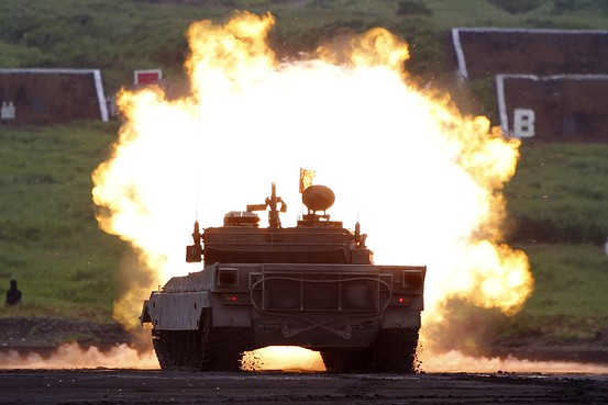 A Japanese Ground Self-Defense Force Type 90 armored tank fires during an annual training session near Mount Fuji in Gotemba, west of Tokyo, Aug. 19, 2014. Reuters