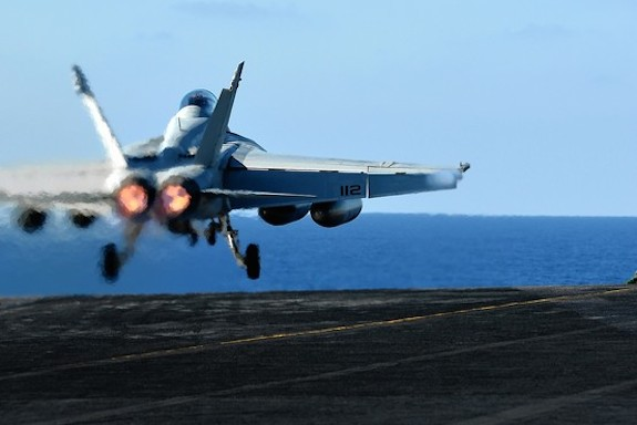 An F/A-18 Hornet takes off for northern Iraq, Aug. 18. AFP/Getty Images