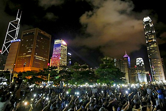 Protesters wave their mobile phones during a rally, after China's legislature has ruled out open nominations in elections for Hong Kong's leader, on Aug. 31. Associated Press