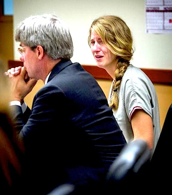 Former Lincoln High School teacher Meredith Claire Powell tears up as she hears her sentence in Pierce County Superior Court on Friday, August 29, 2014. LUI KIT WONG Tacoma News Tribune Staff photographer