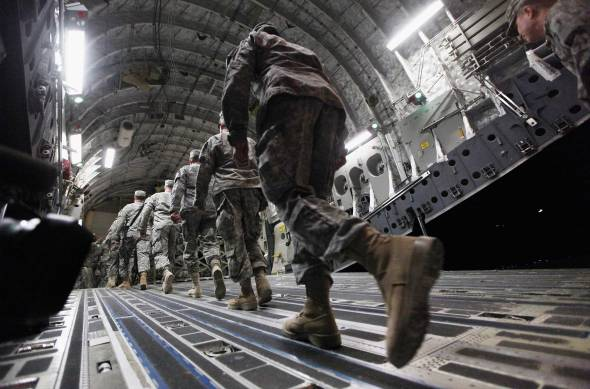 oldiers from the 3rd Brigade, 1st Cavalry Division board a C-17 transport plane to depart from Iraq at Camp Adder, now known as Imam Ali Base, on Saturday Dec. 17, 2011, near Nasiriyah, Iraq.  Around 500 troops from the 3rd Brigade, 1st Cavalry Division ended their presence at Camp Adder, the last remaining American base, and departed in the final American military convoy out of Iraq, arriving into Kuwait in the early morning hours of December 18, 2011.  (AP Photo / Mario Tama)