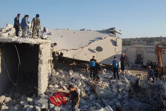 This photo shows what the Edlib News Network says is Syrian citizens checking a damaged house that was targeted by the coalition airstrikes in the village of Kfar Derian on Tuesday. This image, also from the Syrian antigovernment group, was similarly authenticated by the AP. Associated Press