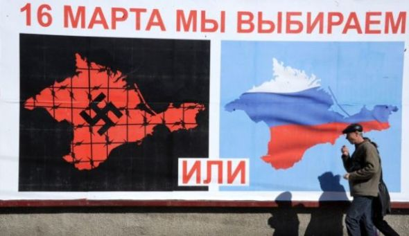 "A poster in Sevastopol reading ""On March 16 we will choose either... or..."", March 13, 2014. Photo by AFP"