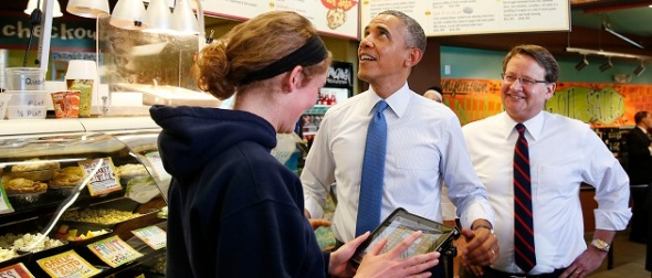 U.S. President Obama and U.S. Rep. Peter order sandwiches from restaurant worker Andrea Byl at Zingerman's Deli in Michigan