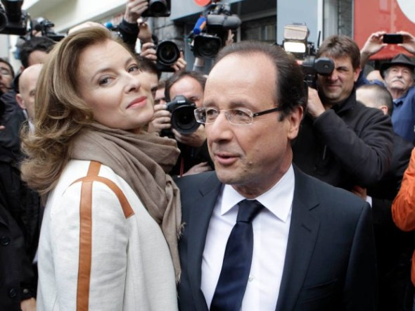 Francois Hollande and his companion Valerie Trierweiler  (AP Photo/Lionel Cironneau, File)