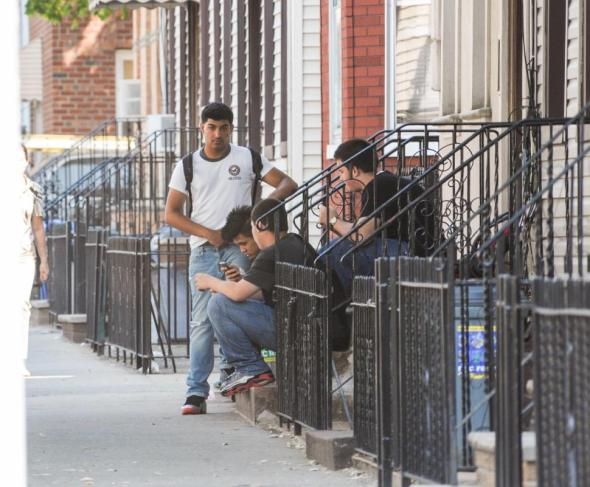 JB NICHOLAS/NEW YORK DAIly newsStudents across the street from Grover Cleveland High School allegedly watch a video of Morsi, performing oral sex on a 16 year-old student.