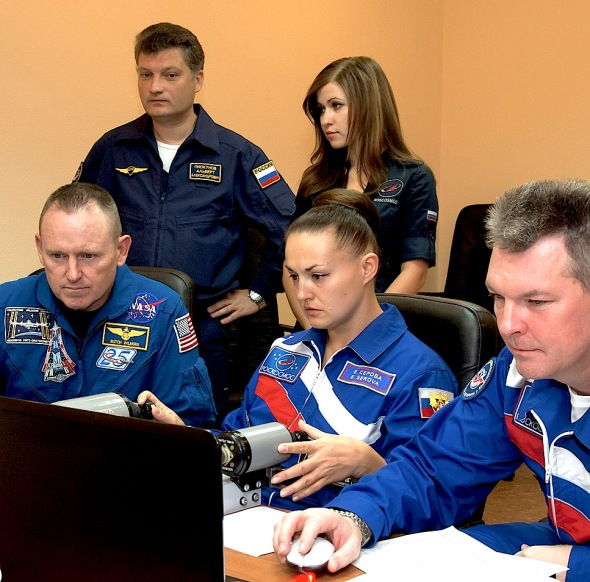 At the Cosmonaut Hotel crew quarters in Baikonur, Kazakhstan, Expedition 41/42 Soyuz Commander Alexander Samokutyaev of the Russian Federal Space Agency, right, brushes up on docking skills on a laptop computer simulator Sept. 17 as prelaunch preparations continue for the crew. Image Credit: NASA/Victor Zelentsov