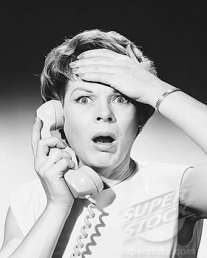 Shocked woman on telephone