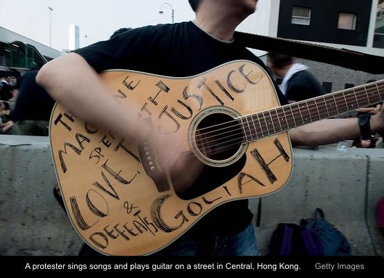 protester-guitar