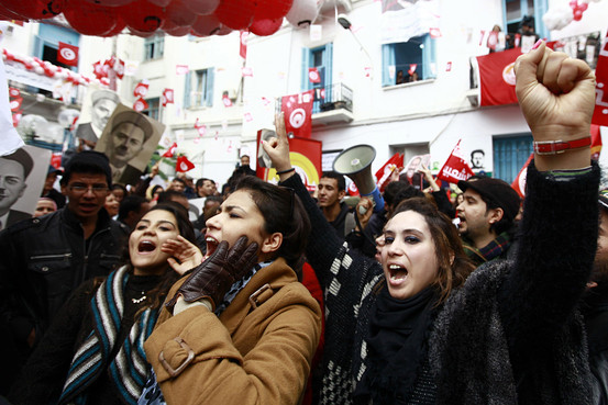 In Tunisia, members of the main labor union body staged a protest calling for the government led by the Islamist Ennahda party to step down in Tunis, Dec. 4, 2013. Reuters