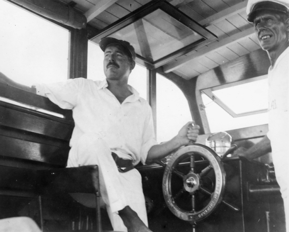 Ernest Hemingway and Carlos Gutierrez aboard Hemingway's boat, the Pilar, 1934. Photograph in the Ernest Hemingway Photograph Collection, John F. Kennedy Presidential Library and Museum, Boston.