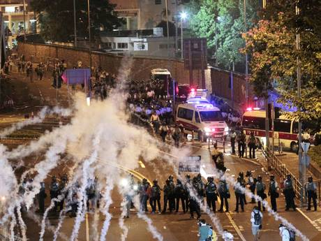 Riot police fire tear gas on student protesters occupying streets surrounding the government headquarters in Hong Kong (AP)