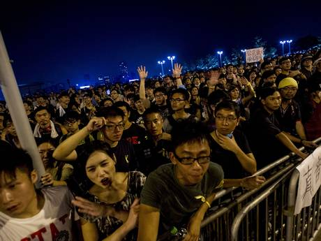Pro-democracy protesters gather outside Government Office at Admiralty district in Hong Kong (AFP)