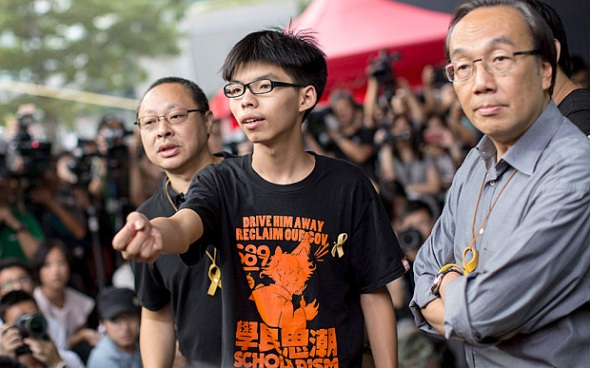 Pro-democracy leaders (L-R) Benny Tai, Joshua Wong and Alan Leong arrive. Philippe Lopez/AFP/Getty Images